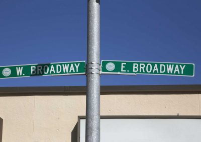 west broadway and east broadway road signs